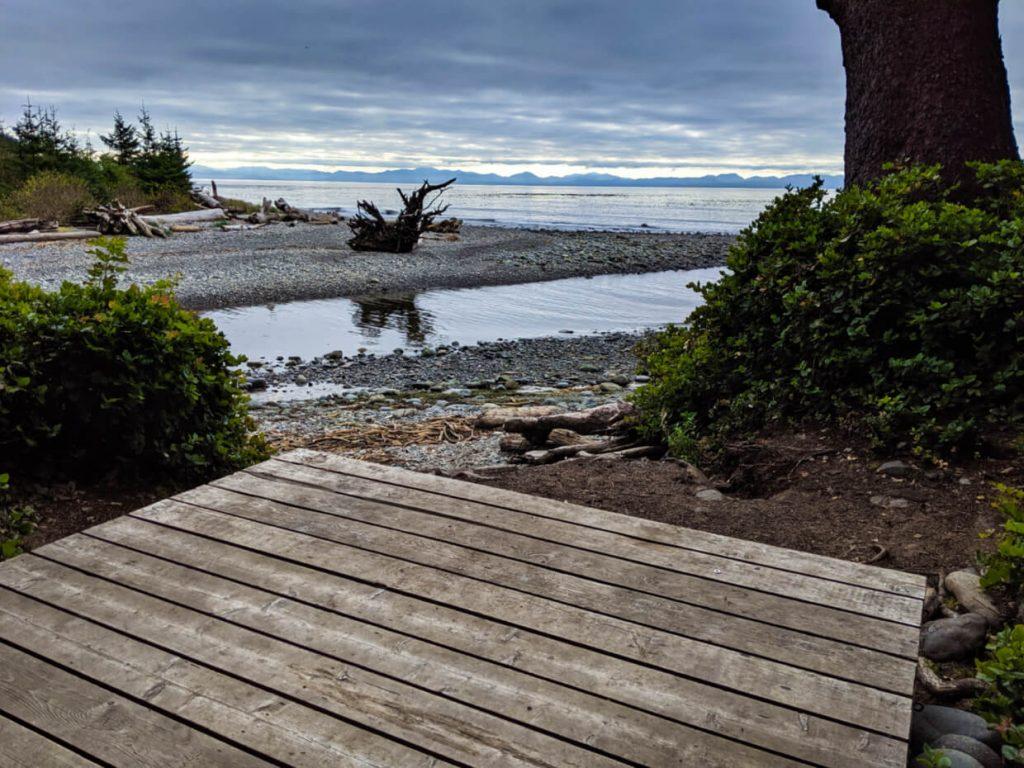Wooden tent pad in front of beach view, Juan de Fuca